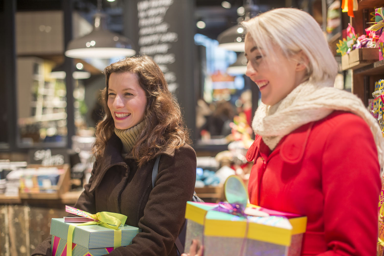 Two young ladies smile as they shop in Lush, Bournemouth.