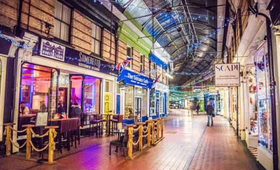 A nighttime scene of Westbourne Arcade.