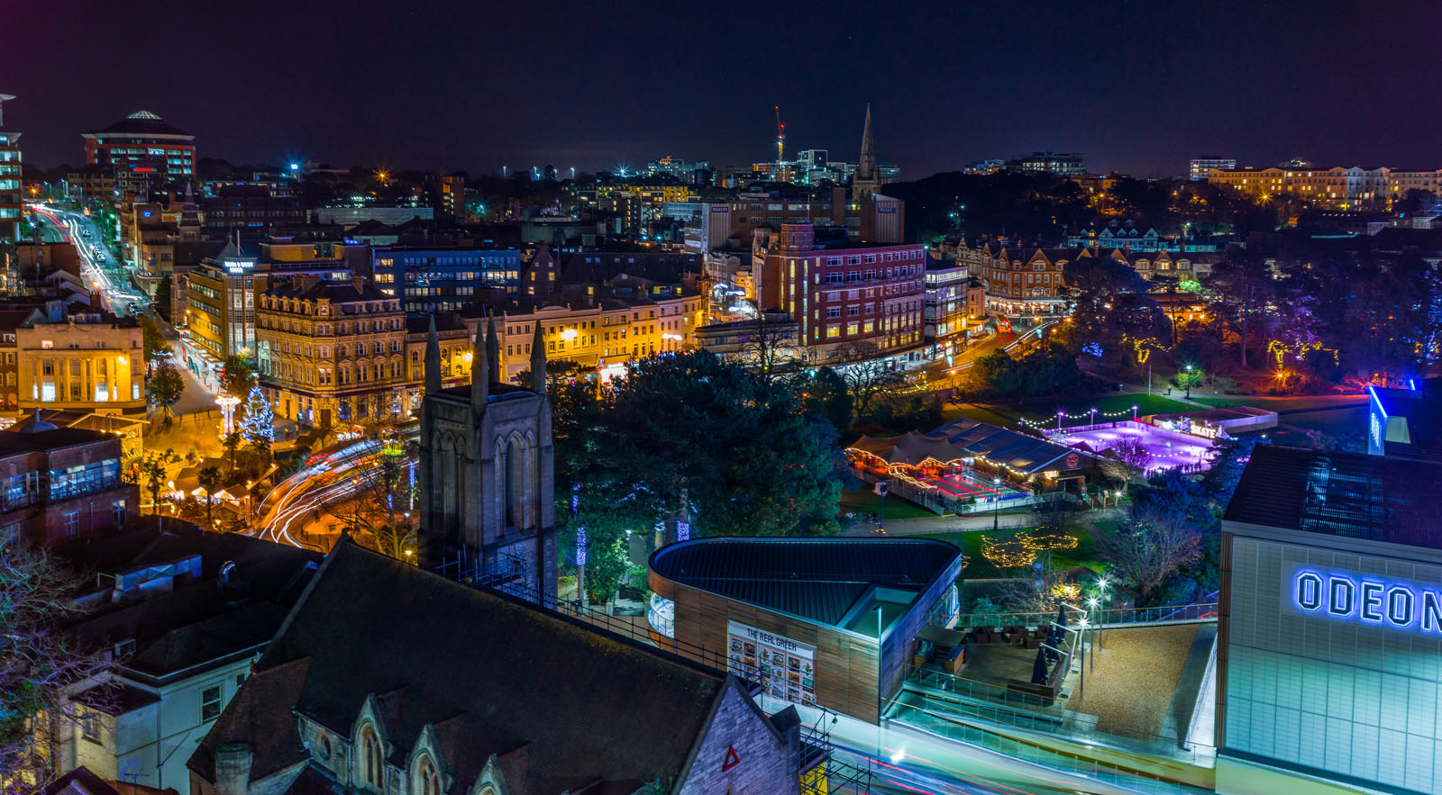 An image of Bournemouth Town Centre at night.