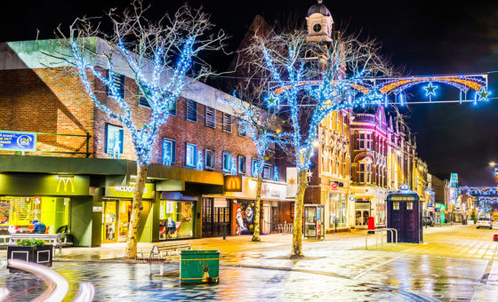 Boscombe High Street at night illuminated by Christmas lights.