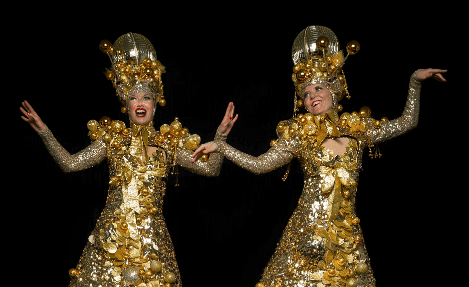 The Glitterbelles Duo in sparkly gold costumes