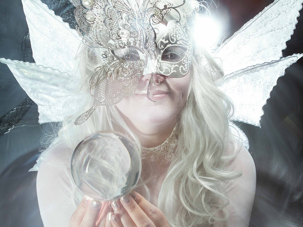 A Winter Fairy character with crystal ball and wings.