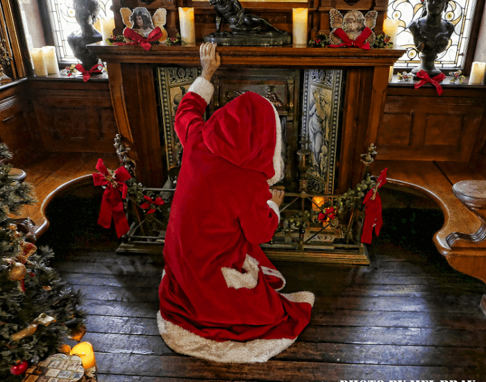 Father Christmas in front of the fireplace at the Russell-Cotes
