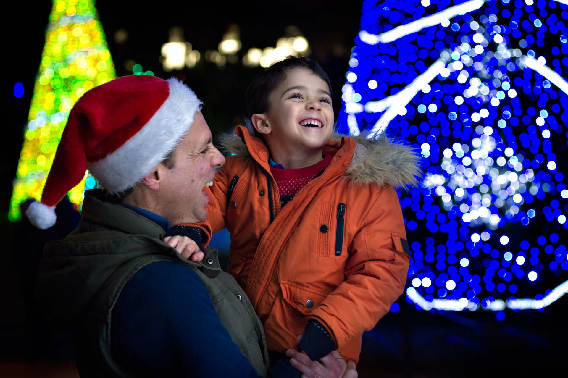 Father and Son smiling at the Christmas Tree Wonderland Trail