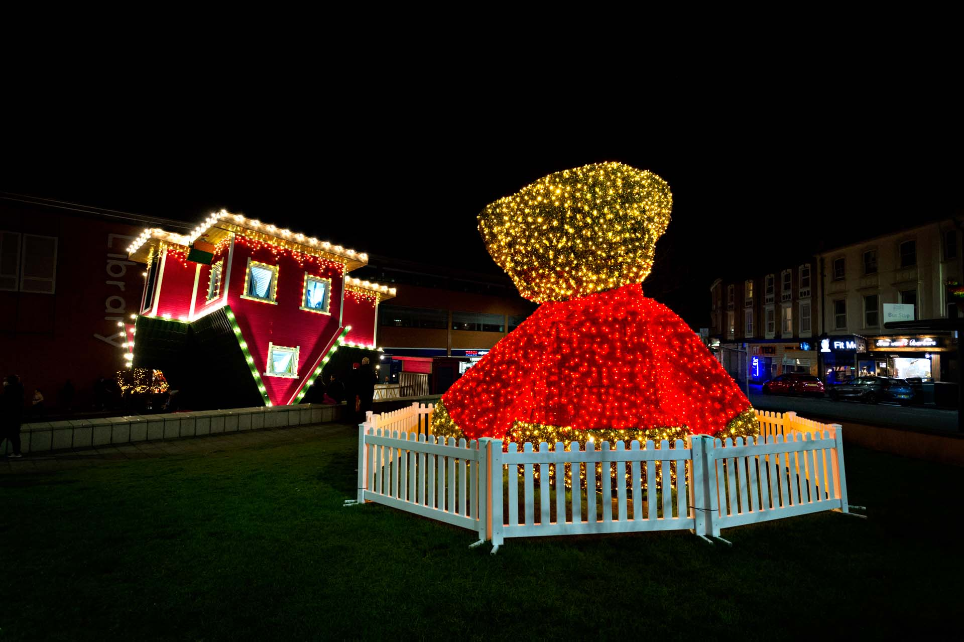 Night time shots of the Upside down house and teddy bear shining bright in the night