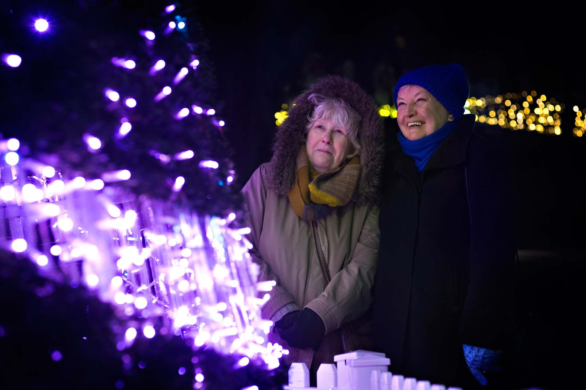 Two women in awe of the Warsaw Christmas Tree