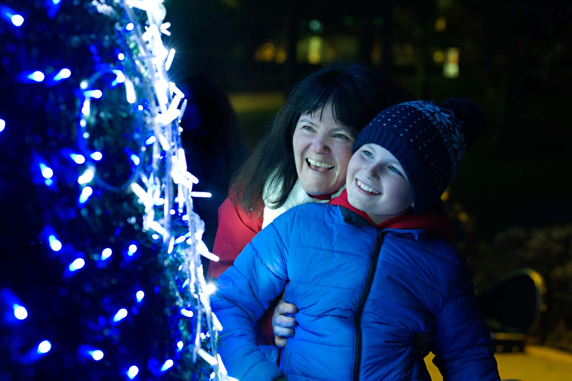 Mum and her son smiling at the Moscow Tree