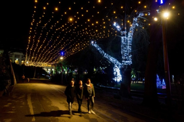 Group of lads walking under the Pinewalk Lights