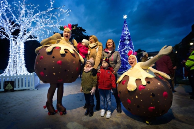 The Roller skating puddings having a photo with some visitors