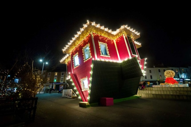 Upside down house lit up in Bournemouth's Triangle