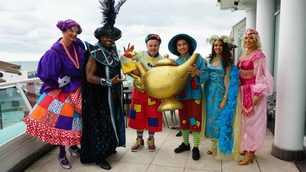 Aladdin cast pose for photo with the magic lamp outside hot rocks in Bournemouth