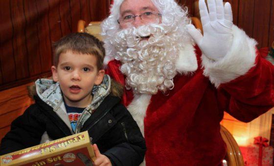 Child sat on Santa's lap in the Grotto in Boscombe