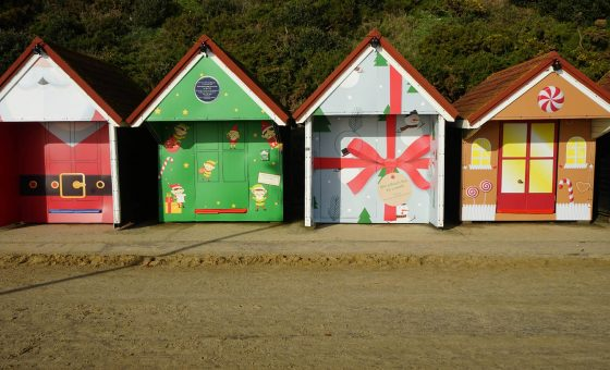 Row of Christmas wrapped Beach huts on Bournemouth beach